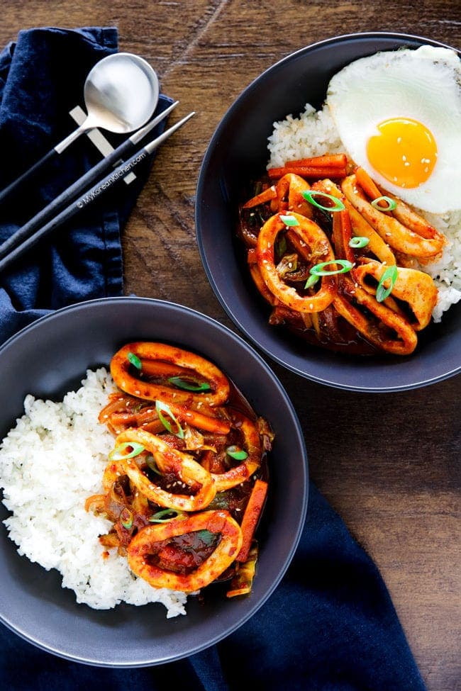 Korean spicy squid served on a bowl of rice