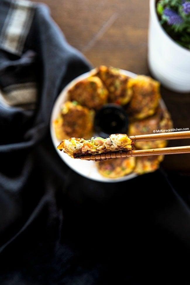 Chopsticks holding a tuna pancake