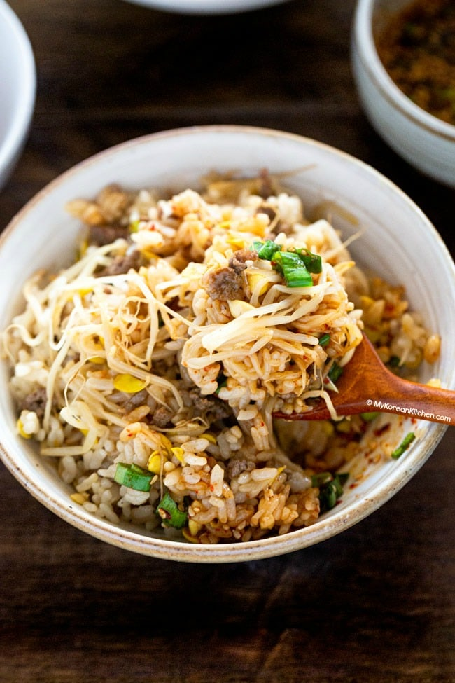 soybean sprout rice scooped on spoon