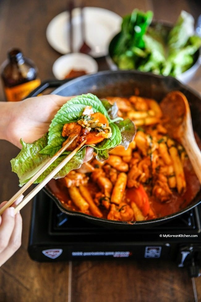 Dak Galbi (Korean spicy chicken stir fry) in a lettuce wrap | MyKoreanKitchen.com
