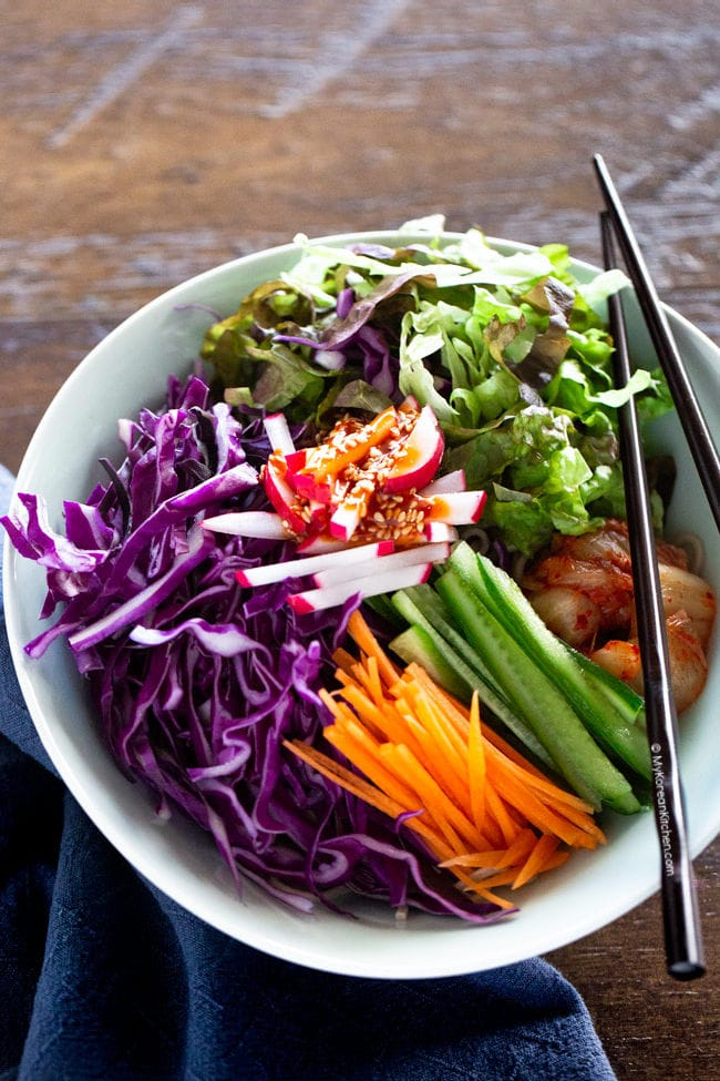 Korean noodle salad topped with spicy gochujang sauce
