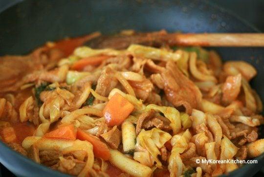Jeyuk-bokkeum (Korean Spicy Pork Stir-Fry) cooking in the wok
