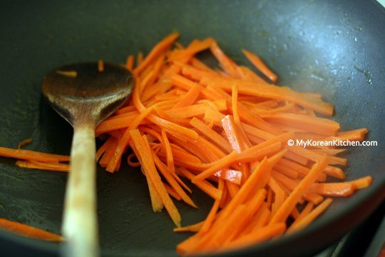 Stir frying carrots for Bibimbap