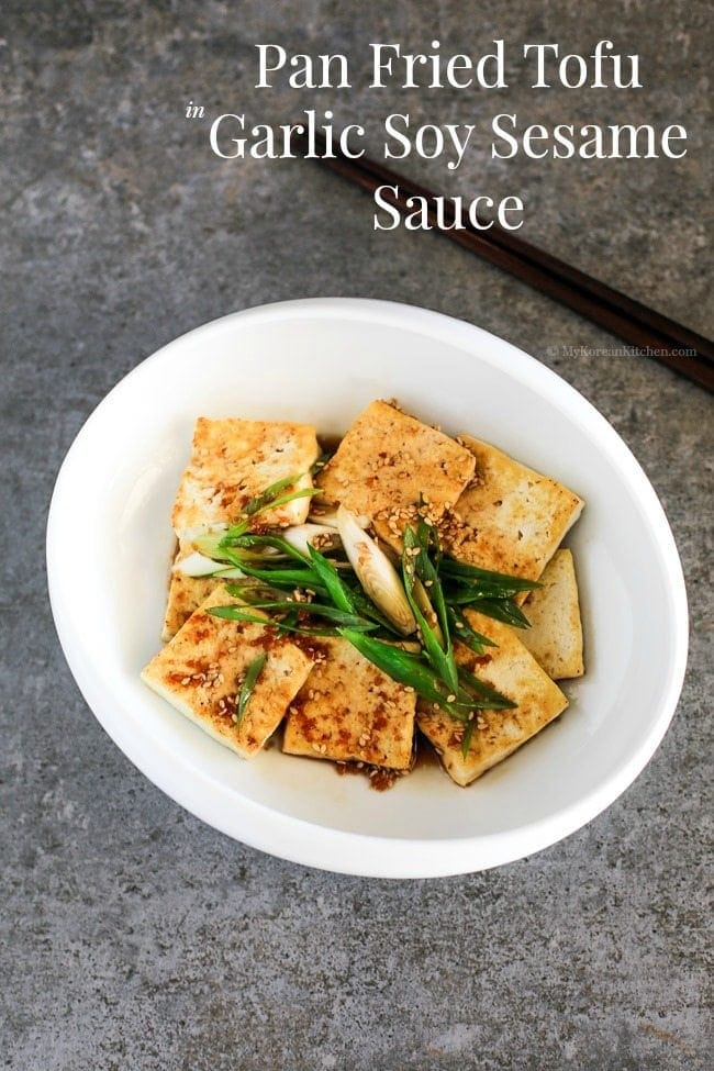 Easy and delicious Korean tofu side dish - Pan Fried Tofu in Garlic Soy Sesame Sauce (Dubu Buchim) recipe. Budget friendly and Vegetarian friendly | MyKoreanKitchen.com