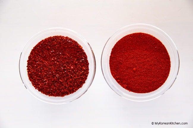 Korean chili flakes and Korean chili powder in two separate bowls