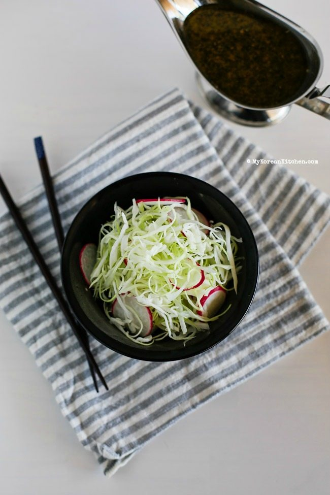 Sweet and Tangy Cabbage Salad - Cabbage and pink radishes served with sweet and tangy roasted sesame seed dressing. It's light, refreshing and crunchy! | MyKoreanKitchen.com