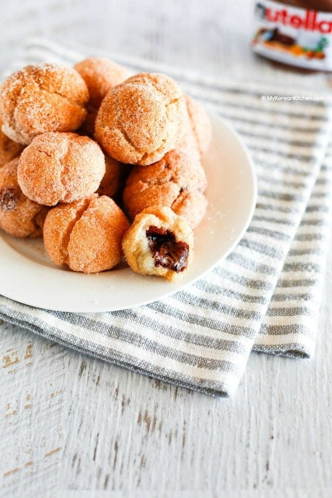 Nutella Stuffed Sweet Rice Flour Doughnut Holes - Outside is crunchy but inside is sticky like mochi rice cakes and gooey! | MyKoreanKitchen.com