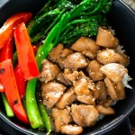 Chicken, broccolini, red bell peppers in a bowl