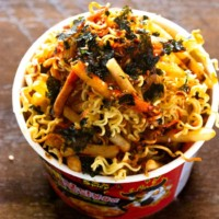 Nuclear fire noodles and french fries loaded in a noodle cup