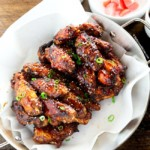 Korean chicken wings serve on paella pan