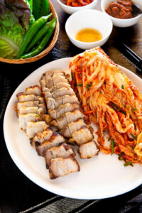 Bite sized air fried pork belly served with kimchi