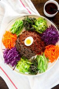 Noodles, vegetables and sauce on a large platter